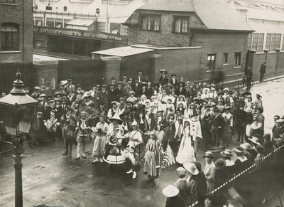 Fancy Dress Parade Leaving the Factory, July 1918 © EMI Group Archive Trust